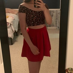 Black top with roses and red skirt